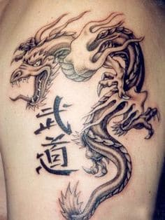 Tribal tattoo meaning dragon The Meaning