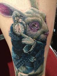 Alice in wonderland tattoo meaning ideas designs sleeve for Looking glass tattoos