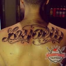 Loyalty tattoo meaning ideas designs on chest for Best script tattoo artist austin