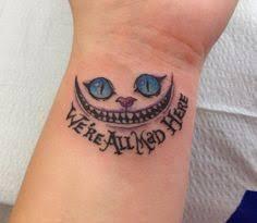 Were All Mad Here Tattoo 24