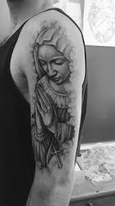 Virgin Mary Tattoo Meaning 14