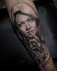 Virgin Mary Tattoo Meaning 16