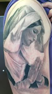 Virgin Mary Tattoo Meaning 32