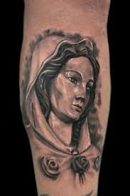 Virgin Mary Tattoo Meaning 33