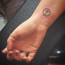 Peace Sign Tattoo Meaning 29
